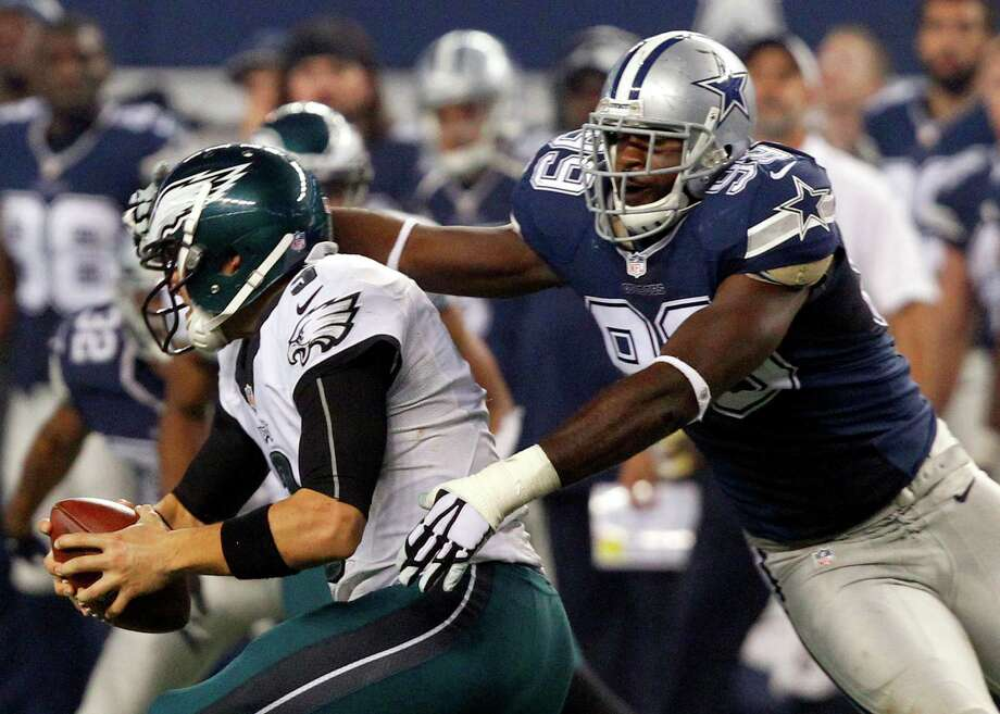 Philadelphia Eagles quarterback Mark Sanchez draws a personal foul from Dallas Cowboys defensive end George Selvie on Nov. 27 at AT&T Stadium. Photo: Richard W. Rodriguez / Richard W. Rodriguez / Fort Worth Star-Telegram / Fort Worth Star-Telegram