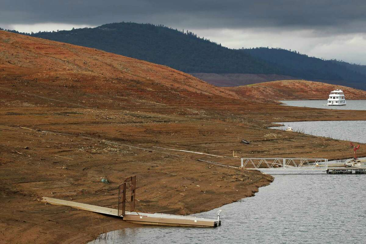 BEFORE : House boats sit idle near the dock area at the low water line of Lake Oroville on Nov. 29, 2014.