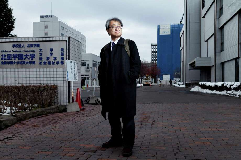 Former The Asahi Shinbun reporter Takashi Uemura in front of Hokusei Gakuen University, where he teaches, in Sapporo, Japan, Nov. 14, 2014. An article Uemura wrote over a quarter century ago that examined whether the Imperial Army had forced women to work in military brothels during World War II has made him and The Asahi the targets of a vitriolic assault by the right-wing news media and politicians. (Ko Sasaki/The New York Times) Photo: KO SASAKI, STR / NYTNS