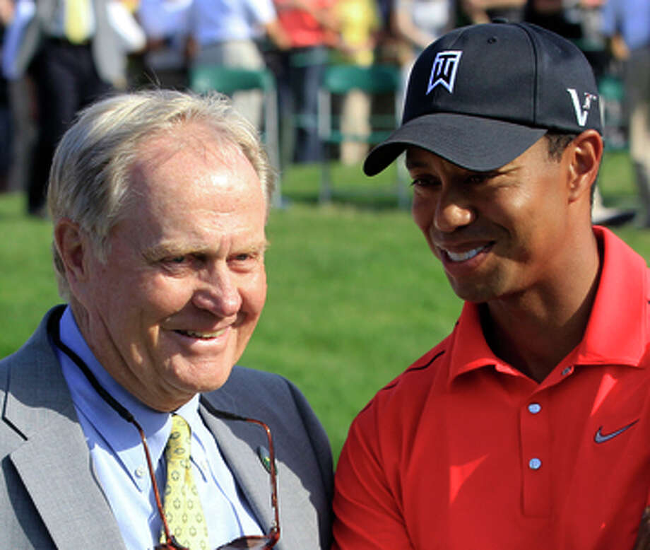 FILe - In this June 3, 2012 file photo, Jack Nicklaus, left, talks with Tiger Woods after Woods won the Memorial golf tournament at the Muirfield Village Golf Club in Dublin, Ohio. Nicklaus was in his customary spot behind the 18th green at Muirfield Village, waiting on the winner _ or in this case, the survivor. Given the meltdowns by top players, this year without Tiger Woods has shown that it's really hard to win or that Woods was really good at it.  (AP Photo/Tony Dejak, File) Photo: Tony Dejak / Associated Press / AP
