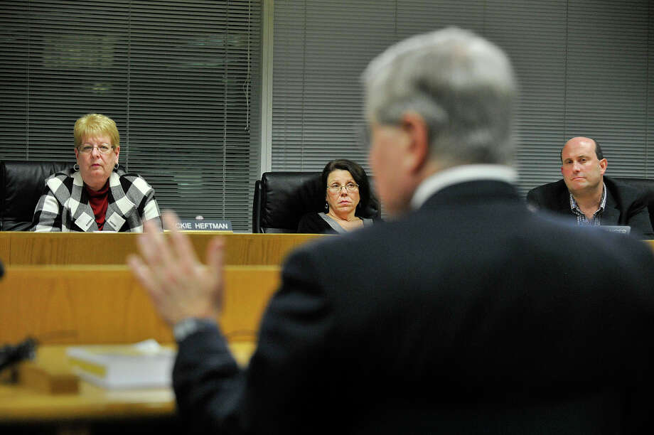 Board of Education President Jackie Heftman, left, Lorraine Olson, center, and Geoff Alswanger listen to attorney Tom Mooney, foreground, the board's lawyer, during the Board of Education meeting at the Stamford Government Center in Stamford, Conn., on Tuesday, Dec. 2, 2014. The meeting dealt with the ramifications of the Stamford High School teacher sex scandal. Photo: Jason Rearick / Stamford Advocate