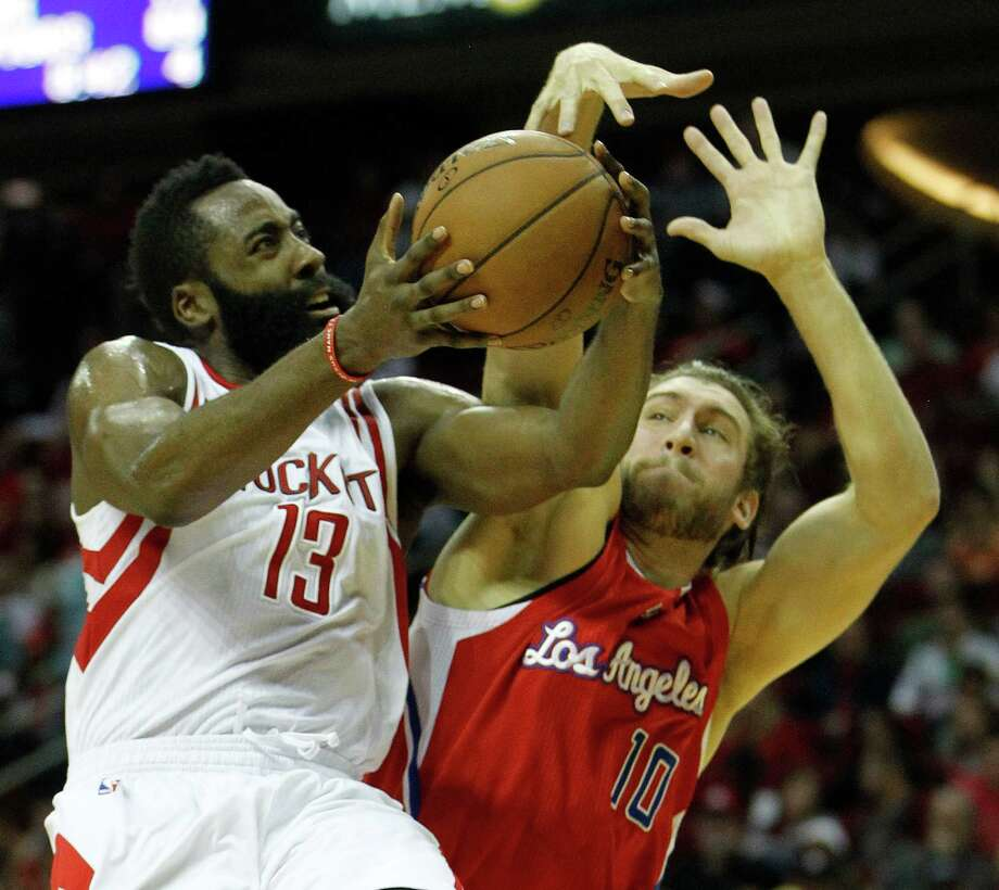 Guard James Harden, left, may feel the pressure from the Clippers' Spencer Hawes but not from carrying the load for the injury-ravaged Rockets. Photo: Karen Warren, Staff / © 2014 Houston Chronicle