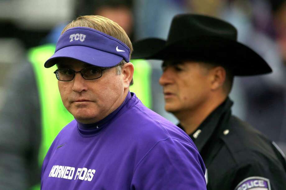 TCU's Gary Patterson waits for the kifkoff against Kansas in Lawrence, Kan., on Nov. 15, 2014. Photo: Orlin Wagner /Associated Press / AP
