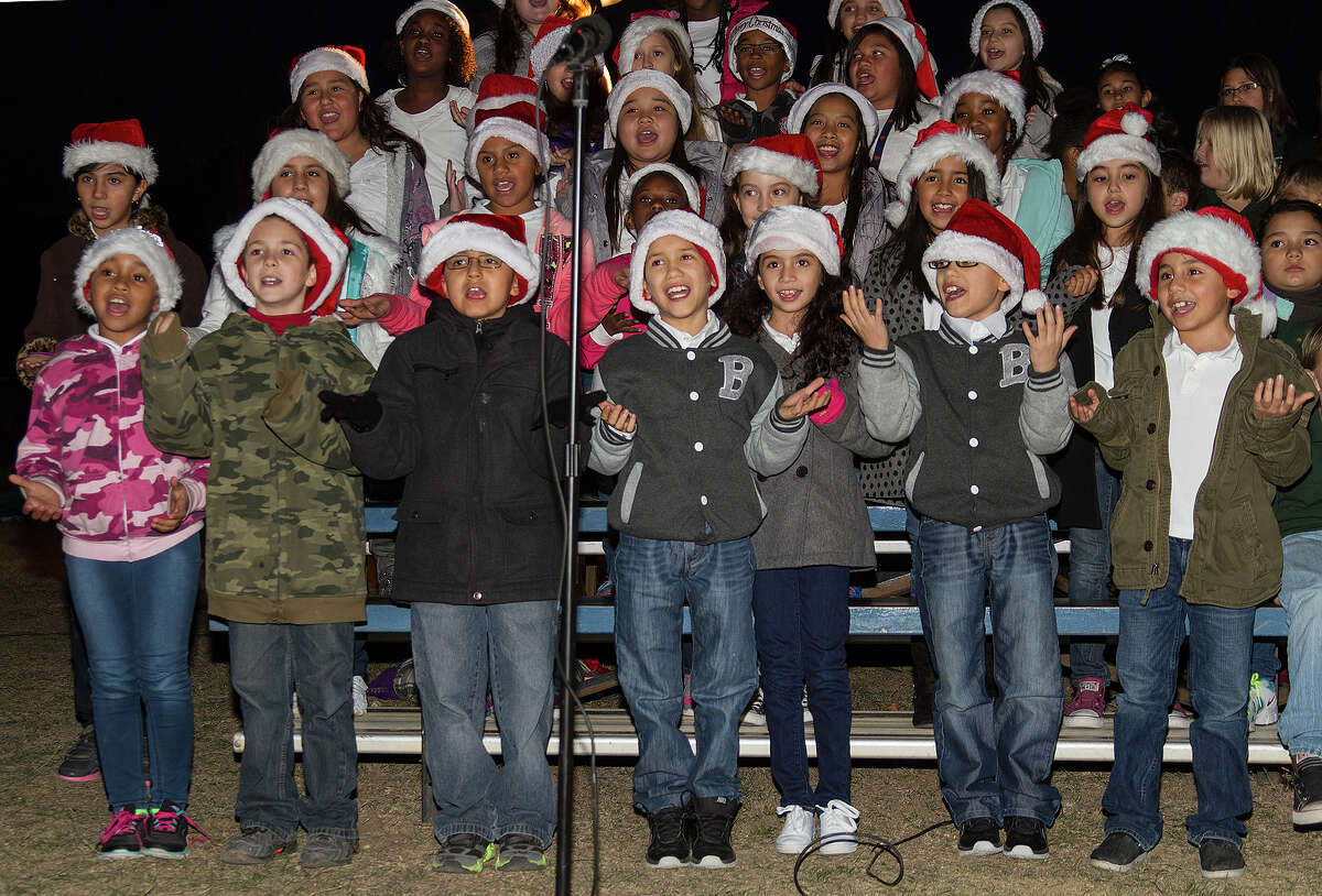 Salinas Elementary School choir sing to open the tree lighting ceremony, Tuesday, Dec. 2, 2014 in Universal City.