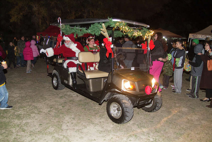 Santa makes his way through the crowd at Universal City's annual tree lighting ceremony, Tuesday, Dec. 2, 2014.