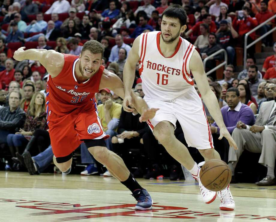 Kostas Papanikolaou, right, is among several reserves who have excelled when called to play bigger roles as a result of injuries to four of the top eight Rockets. Photo: Pat Sullivan, STF / AP