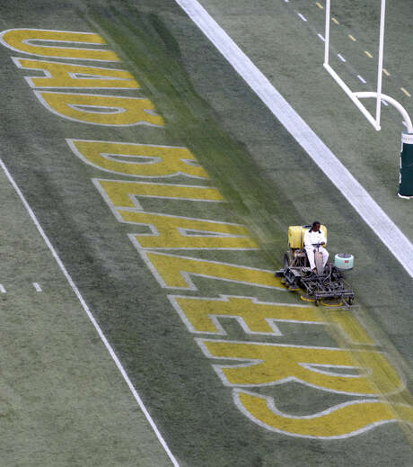 Much like UAB's football program, a worker sees to it that the Blazers' logo is erased from sight in the end zone at Legion Field in Birmingham, Ala. Photo: MARK ALMOND, MBI / AL.COM