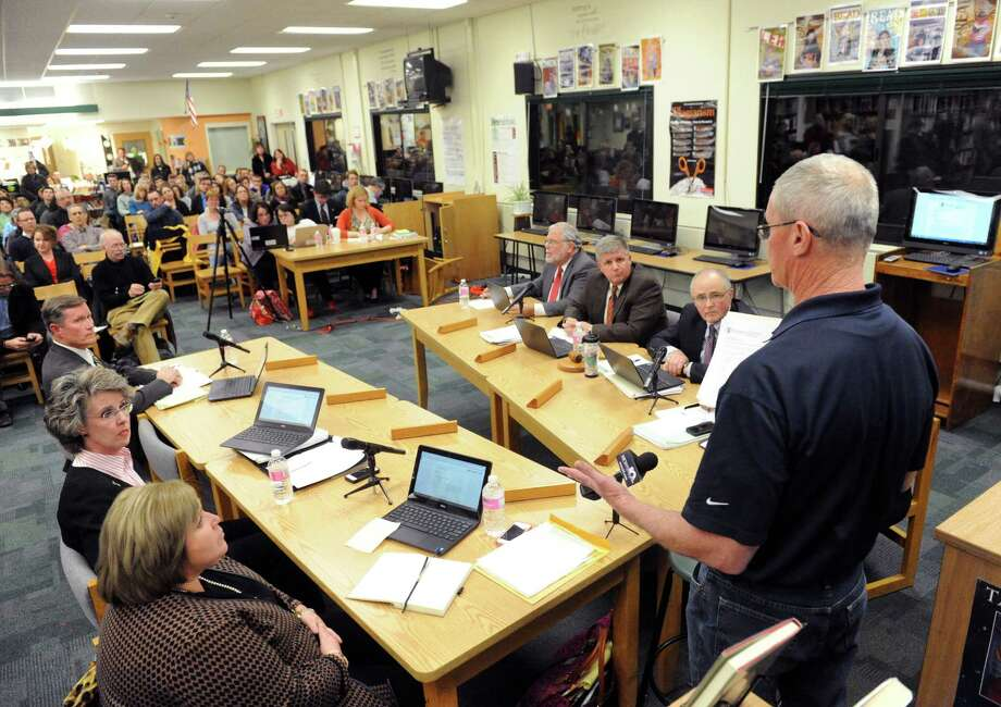 James Waltersdorf of Clifton Park, right, addresses the Shenendehowa School Board on their proposed bathroom policy for transgender students on Tuesday Dec. 2, 2014 in Clifton Park, N.Y.(Michael P. Farrell/Times Union) Photo: Michael P. Farrell / 00029679A