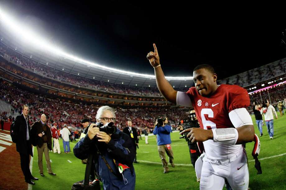 TUSCALOOSA, AL - NOVEMBER 29:  Blake Sims #6 of the Alabama Crimson Tide celebrates as he runs off the field after defeating the Auburn Tigers in the Iron Bowl at Bryant-Denny Stadium on November 29, 2014 in Tuscaloosa, Alabama. The Alabama Crimson Tide defeated the Auburn Tigers 55 to 44.  (Photo by Kevin C. Cox/Getty Images) Photo: Kevin C. Cox, Staff / 2014 Getty Images