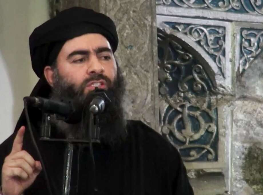 FILE - This file image made from video posted on a militant website Saturday, July 5, 2014, which has been authenticated based on its contents and other AP reporting, purports to show the leader of the Islamic State group, Abu Bakr al-Baghdadi, delivering a sermon at a mosque in Iraq. Lebanese authorities have detained a wife and son of the leader of the Islamic State group and she is being questioned, two senior Lebanese officials said Tuesday, Dec. 2, 2014. (AP Photo/Militant video, File) Photo: Uncredited, HOEP / Militant video