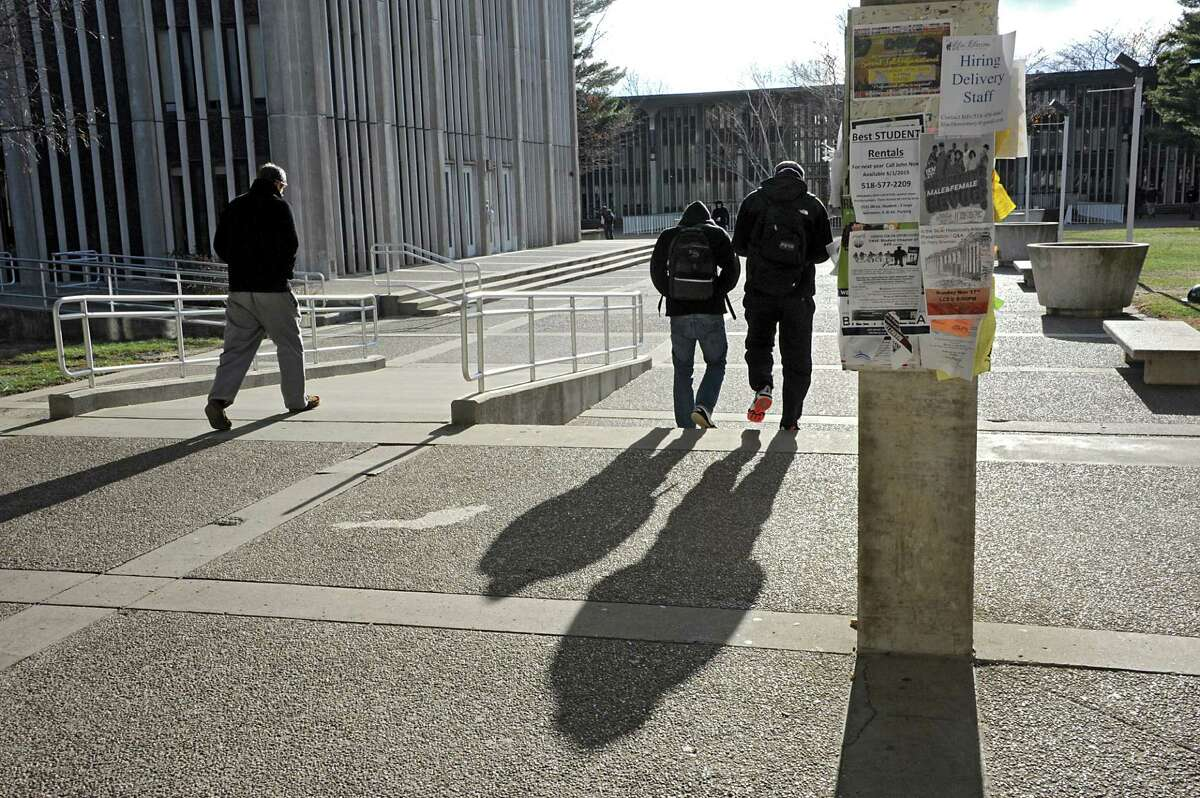 University at Albany students walk through Dutch Quad on the main campus Tuesday, Nov. 18, 2014, in Albany, N.Y. (Lori Van Buren / Times Union archive)