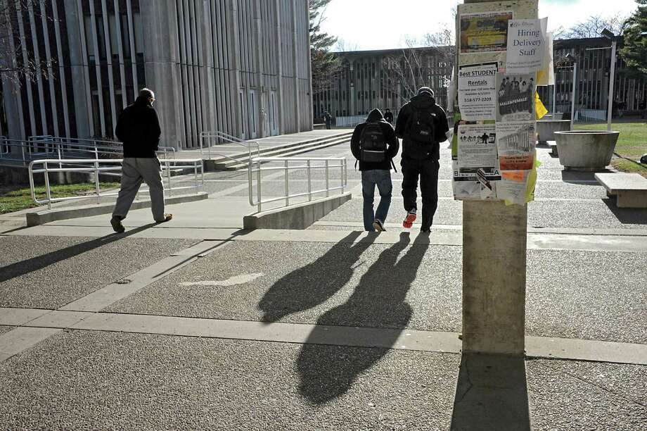 University at Albany students walk through Dutch Quad on the main campus  Tuesday, Nov. 18, 2014, in Albany,  N.Y. (Lori Van Buren / Times Union archive) Photo: Lori Van Buren / 00029538A
