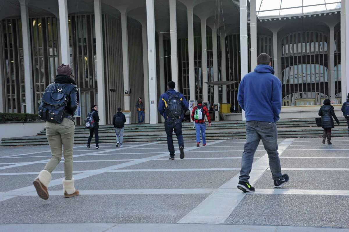 University at Albany students walk from classes at UAlbany Tuesday, Nov. 18, 2014, in Albany, N.Y. (Lori Van Buren / Times Union archive)