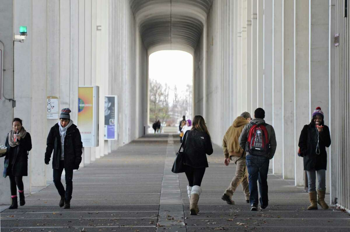 University at Albany students walk near the Campus Center Tuesday, Nov. 18, 2014, at UAlbany in Albany, N.Y. (Lori Van Buren / Times Union archive)