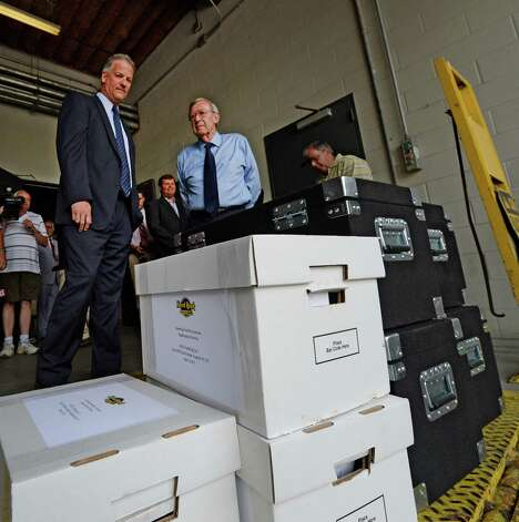 Capital OTB's John Signor, left and Rensselaer Mayor Dan Dwyer, right watch as the Rensselaer casino bid documents are delivered at the New York State Gaming building Monday morning June 30, 2014 in Schenectady, N.Y. The deadline for bids to hold a license for one of seven full service casinos in New York State ended Monday at 4 p.m.   (Skip Dickstein / Times Union) Photo: SKIP DICKSTEIN / 00027558A