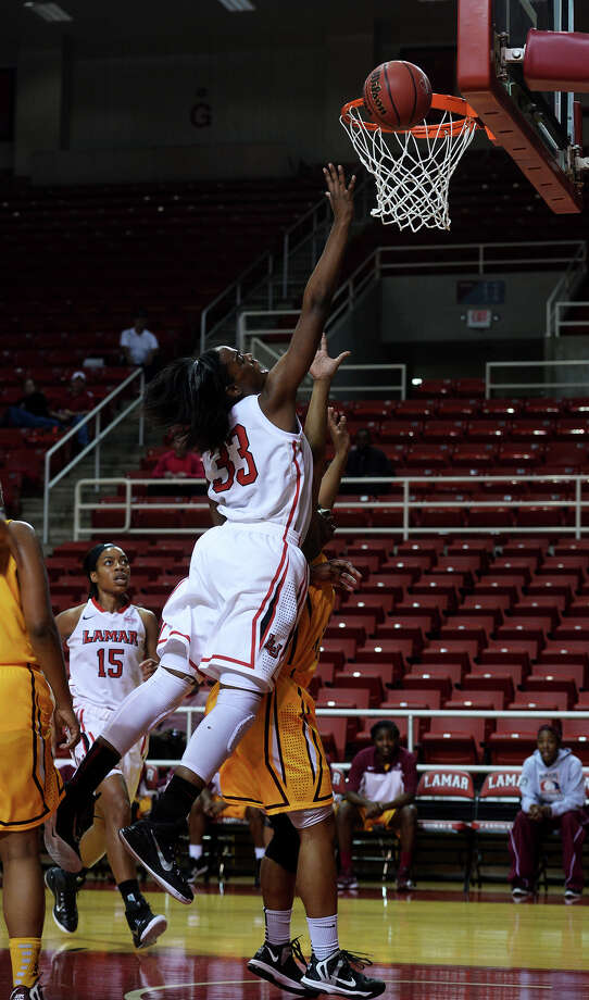 Lamar's Kiandra Bowers, No. 33, jumps for a shot against Huston-Tillotson on Tuesday. The Lamar Lady Cardinals hosted Huston-Tillotson Lady Rams at the Montagne Center on Tuesday night. Photo taken Tuesday 12/2/14 Jake Daniels/The Enterprise Photo: Jake Daniels / ©2014 The Beaumont Enterprise/Jake Daniels