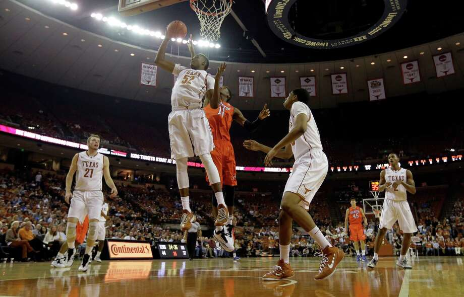 Texas' Myles Turner grabs a rebound against Texas-Arlington during the second half. The Longhorns won 63-53. Photo: Eric Gay, STF / Associated Press / AP