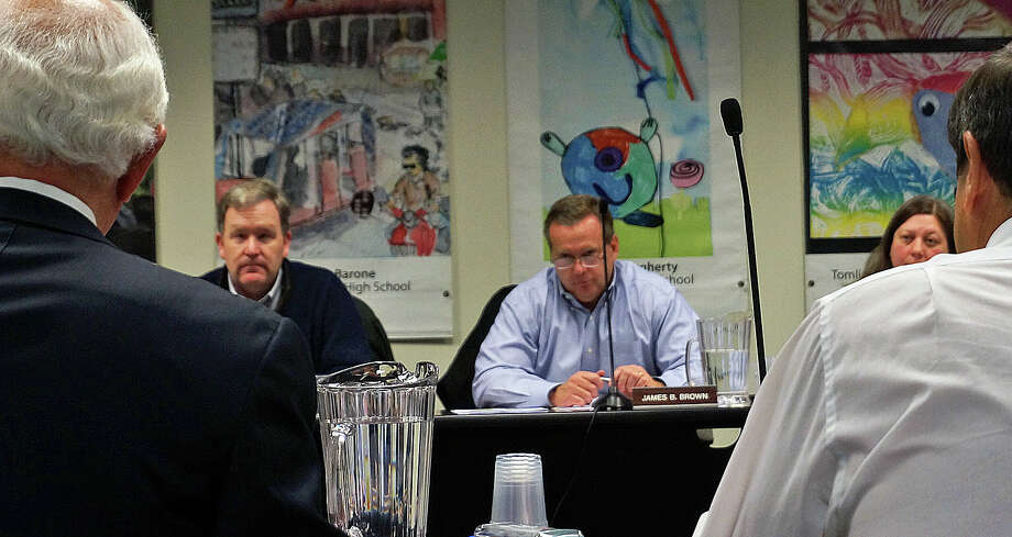 Penfield Building Committee Chairman James Bradley, left, and Recreation Director Gerald Lombardo, right, answer questions from the Board of Finance Tuesday night. Photo: Genevieve Reilly / Fairfield Citizen