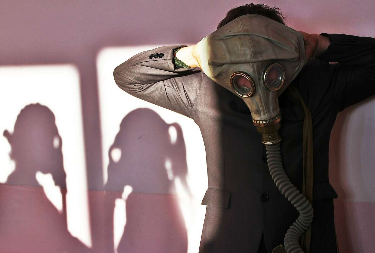TOPSHOTS A Belarus senior school pupil wears a gas mask during a fire safety drill at a school in the village of Krevo, some 100 kilometers northwest from Minsk, on December 2, 2014. AFP PHOTO / SERGEI GAPONSERGEI GAPON/AFP/Getty Images