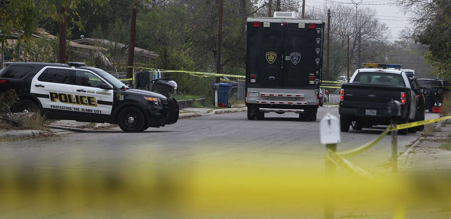 San Antonio police investigate the scene Wednesday December 3, 2014 on Corliiss Street on the East Side where a body has been found inside a car. Photo: JOHN DAVENPORT, San Antonio Express-News / ©San Antonio Express-News/John Davenport