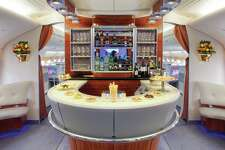 The Airbus A380 flies between Houston and Dubai for Emirates Airlines. First class and business class passengers can use the onboard lounge that serves cocktails and hors d'overs.