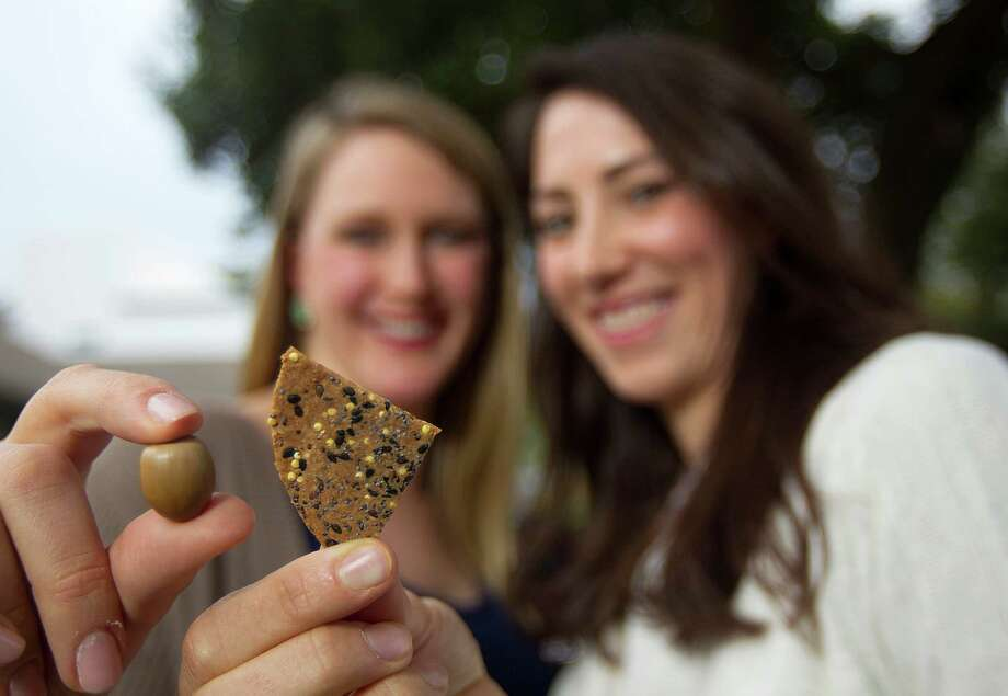Mighty Wild's Mimi Brown, left, and Aline Copp say their acorn crackers taste good while being gluten-free and organic. Photo: Johnny Hanson, Staff / © 2014  Houston Chronicle