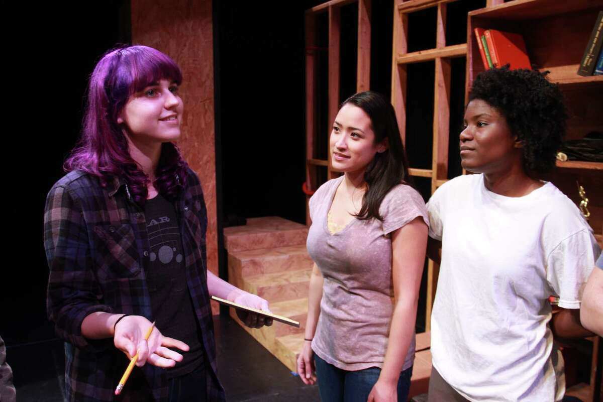 """Playwright Kendall Kaminsky, from left, talks to cast members Suzelle Palacios and Shunte Lofton before rehearsal of the University of Houston School of Theatre and Dance presentation of """"The End of Side A."""""""