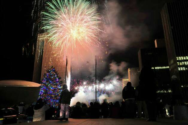 Fireworks explode in the sky during the tree lighting ceremony at the Empire State Plaza on Sunday, Dec. 8, 2013 in Albany, NY.    (Paul Buckowski / Times Union) Photo: PAUL BUCKOWSKI / 00024611A