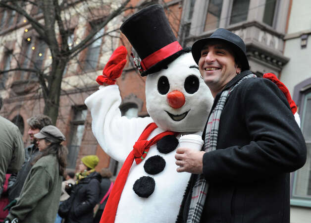Henry Blanck of Albany gets his photo taken with Frosty The Snowman during the 30th annual Victorian Stroll Sunday Dec. 2, 2012 in Troy, N.Y. (Lori Van Buren / Times Union) Photo: Lori Van Buren / 00020288A
