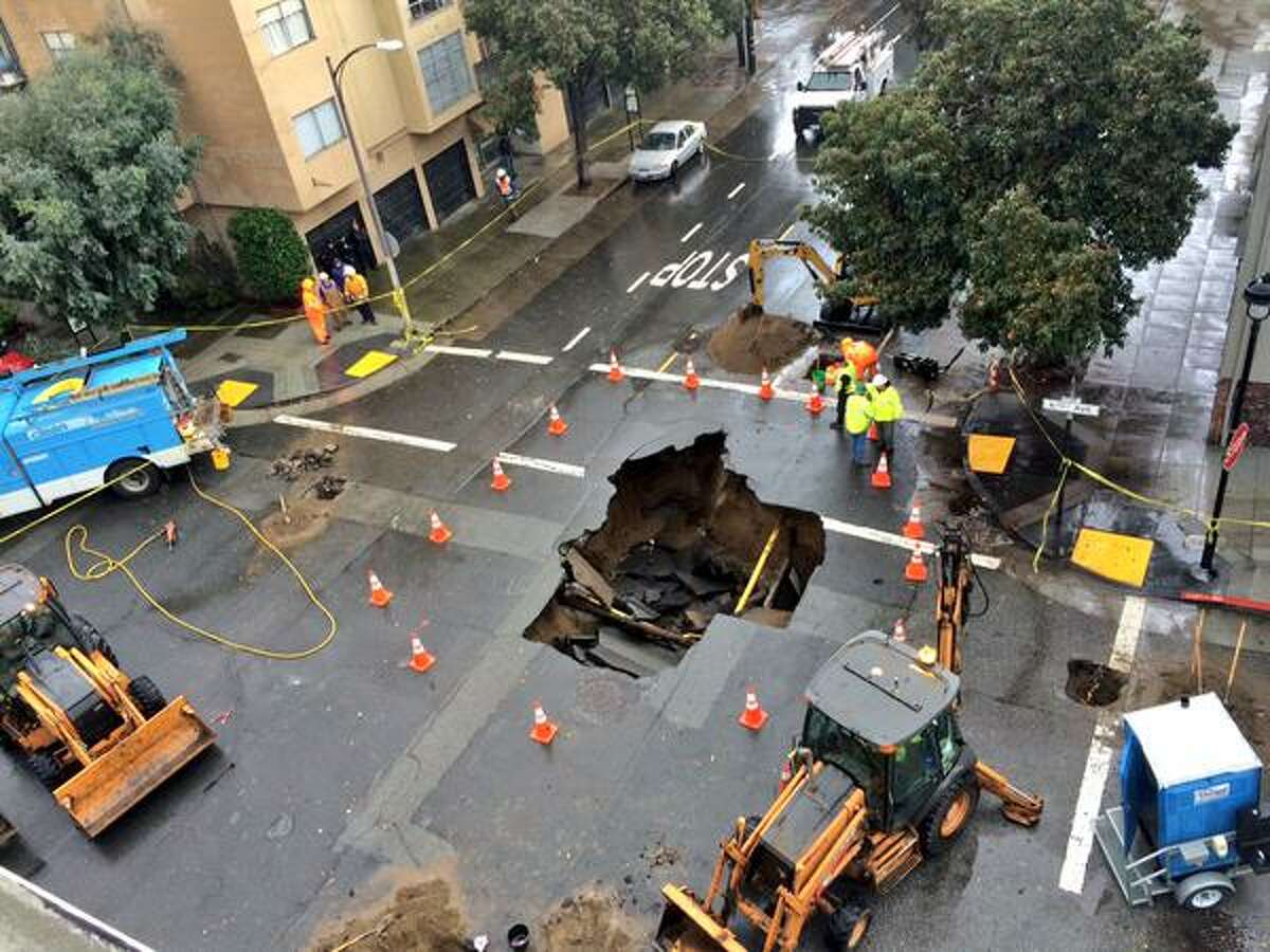 A 10 foot wide sinkhole at 6th and Lake Streets in the Richmond District of San Francisco appeared early Wednesday morning, Dec. 3, 2014.