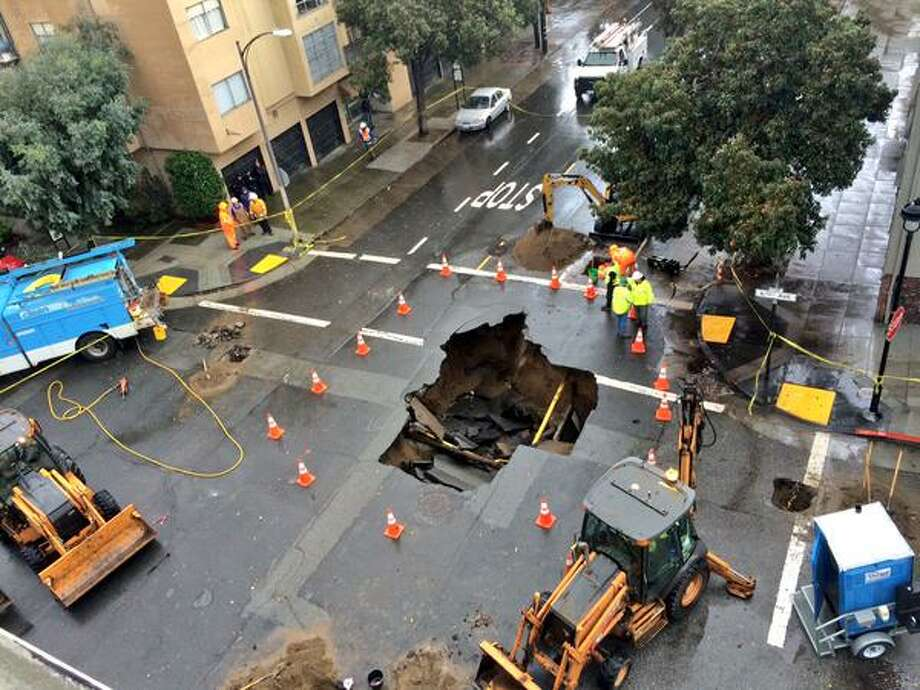 A 10 foot wide sinkhole at 6th and Lake Streets in the Richmond District of San Francisco appeared early Wednesday morning, Dec. 3, 2014. Photo: The Chronicle / Evan Sernoffsky