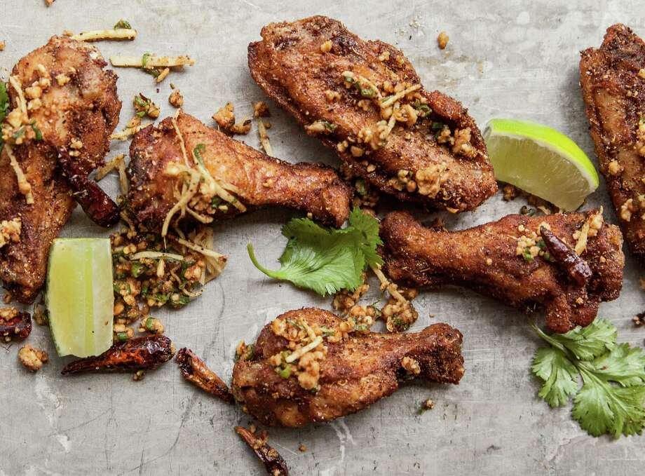 Mission Chinese Hot Wings: Crispy fried wings tossed with Sichuan pepper and ginger inspired by Danny Bowien, New York. One of the new bar items from Underbelly's Wine Bar Menu. Photo: Julie Soefer / Julie Soefer
