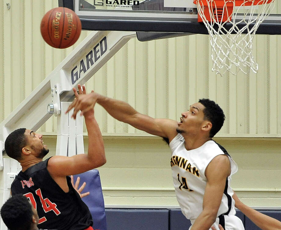 Brennan's Jordan Murphy, right, defends Wagner's Giovanni Collins in the first half of a high school basketball game, Tuesday, Dec. 2, 2014, in San Antonio. Brennan won 86-51. (Darren Abate/For the Express-News) Photo: Darren Abate, FRE / Express-News / Express-News
