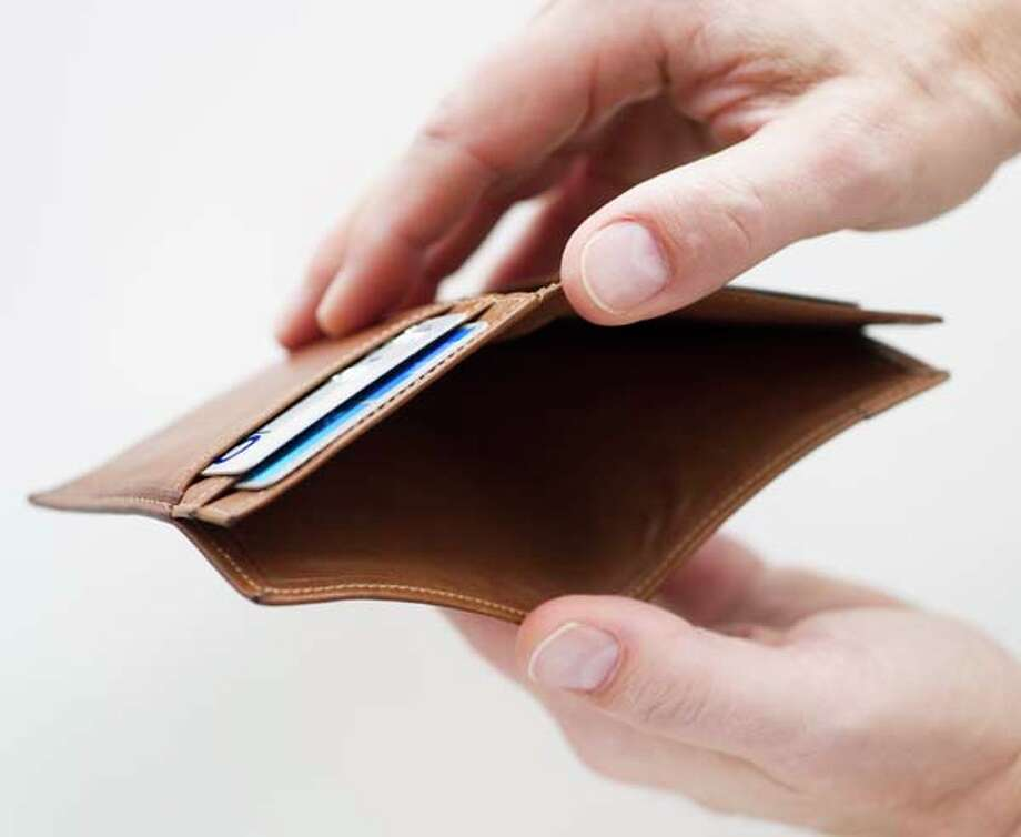 Missing funds Watch for unpaid bills or extra credit cards lying around, and keep an eye on the gifts being given during the holidays. If the person is giving dramatically more or less than in previous years, it may be time to have a conversation about finances. Photo: Tom Grill, Getty Images / (c) Tom Grill