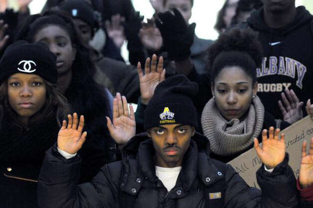 University at Albany students demonstrate against the Ferguson decision Wednesday at the main campus in Albany, N.Y. (Michael P. Farrell/Times Union)