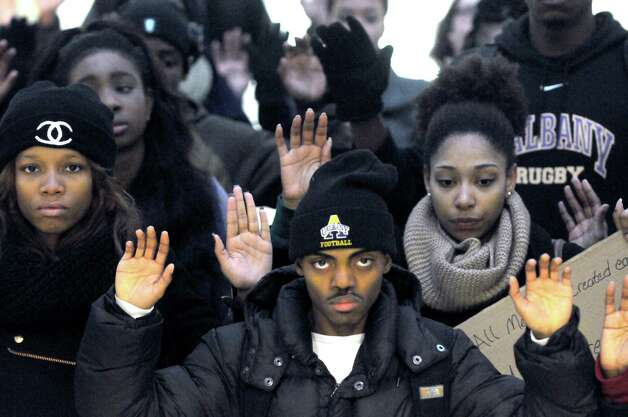 Joshua Johnson, center, is joined by fellow University at Albany students to demonstrate against the grand jury decision in Ferguson, Mo. Wednesday Dec. 3, 2014, at University Hall in Albany, N.Y. The protest was organized by Iota Phi Theta fraternity and Zeta Phi Beta sorority. (Michael P. Farrell/Times Union) Photo: Michael P. Farrell