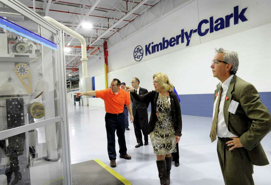 Left, Gary Wright, manager of the Kimberly Clark Mill in New Milford, Conn., conducts a tour of the facility for, among others, New Milford Mayor Pat Murphy, center and  State rep. Richard Smith, right.  The Kimberly-Clark recently underwent a $28 million, 400,000 square foot capital investment. Wednesday, Dec, 3, 2014, the company held a ribbon-cutting ceremony attended by New Milford Mayor Pat Murphy as well as area state legislators. Photo: Carol Kaliff / The News-Times