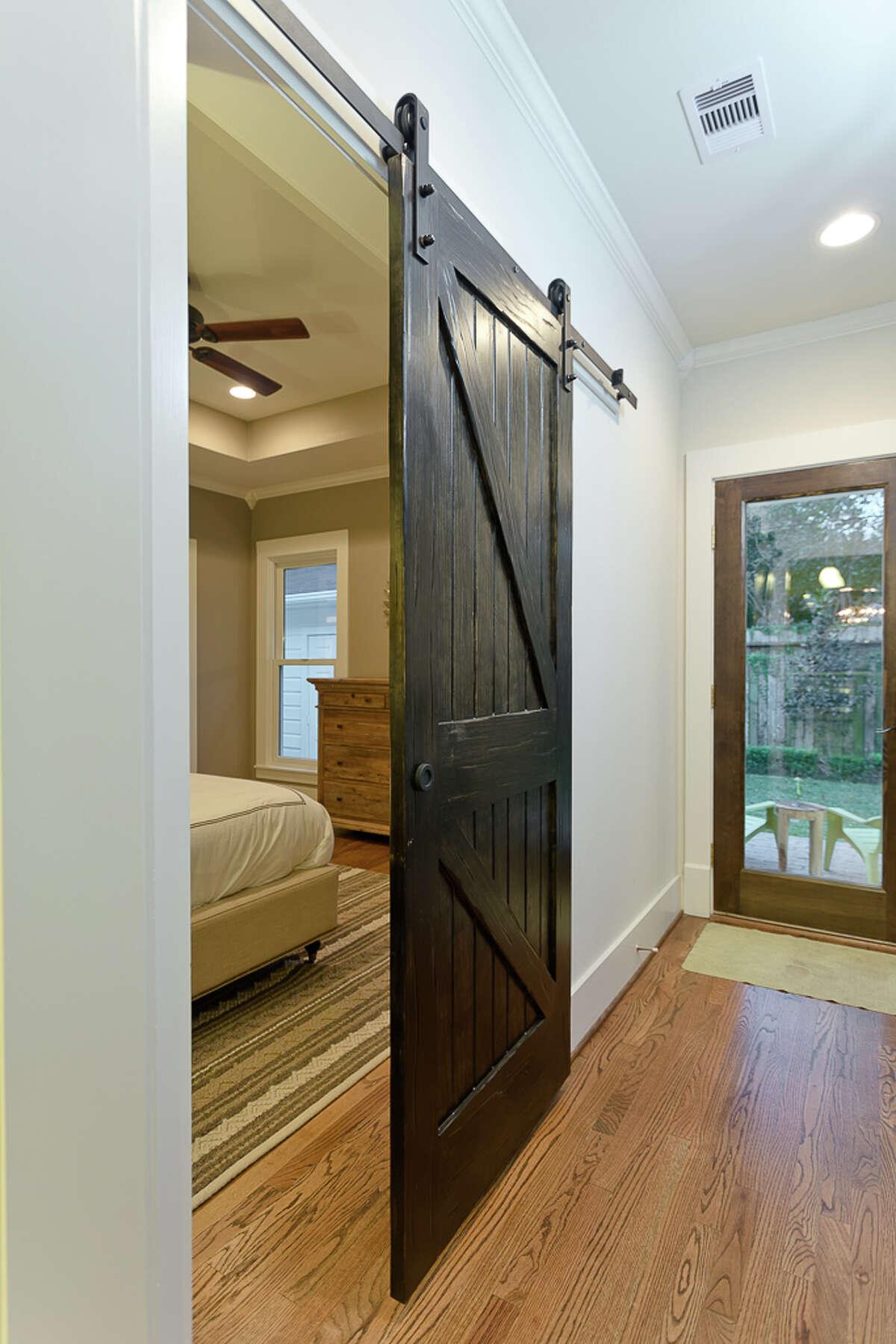 1920s North Norhill bungalow The master bedroom's door is designed to look like a barn door.