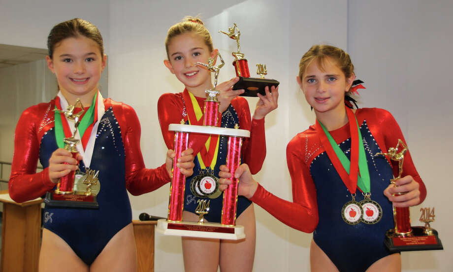 Darien YMCA Level 3 house team gymnasts Anna Primmer, Ali Kolman and Treasa Brown rocked the podium at the Trumbull YMCA Harvest Invitational meet. Photo: Contirbuted, Contributed / Darien News