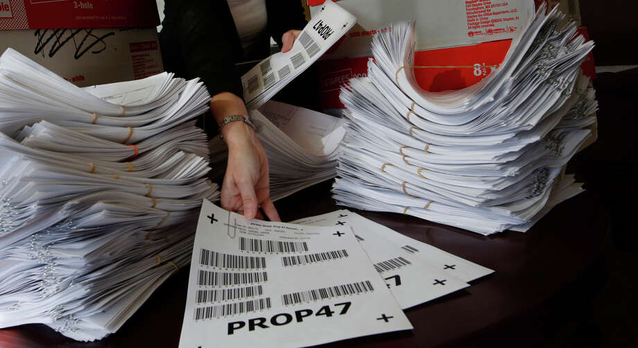 A deputy district attorney with the County of San Diego is seen in her downtown office with 4,800 Proposition 47 petitions. Photo: Don Bartletti / McClatchy-Tribune News Service / Los Angeles Times