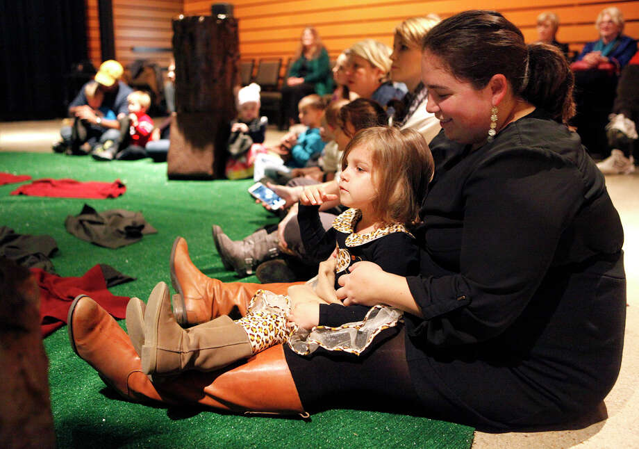 "Megan E. Ortiz and her daughter Pistol Brewer, 3, wait for the ""Wake Up, Brother Bear"" performance to begin Saturday, Nov. 15, 2014 which is put on by The Magik Theatre inside the Pearl Studio. The production is meant for children 5-years-old and under and allows the children to interact with the actors and set. There are four performances scheduled so far on December 13-14 and 20-21, all at the Pearl Studio. Photo: Cynthia Esparza, For The San Antonio Express-News / For The San Antonio Express-News / For the San Antonio Express-News"