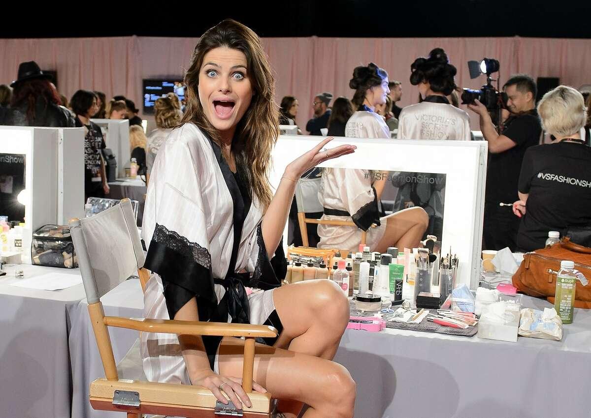 SAY CHEESE, FONTANA: Brazilian model Isabeli Fontana mugs for the camera backstage at the Victoria's Secret Fashion Show in London.