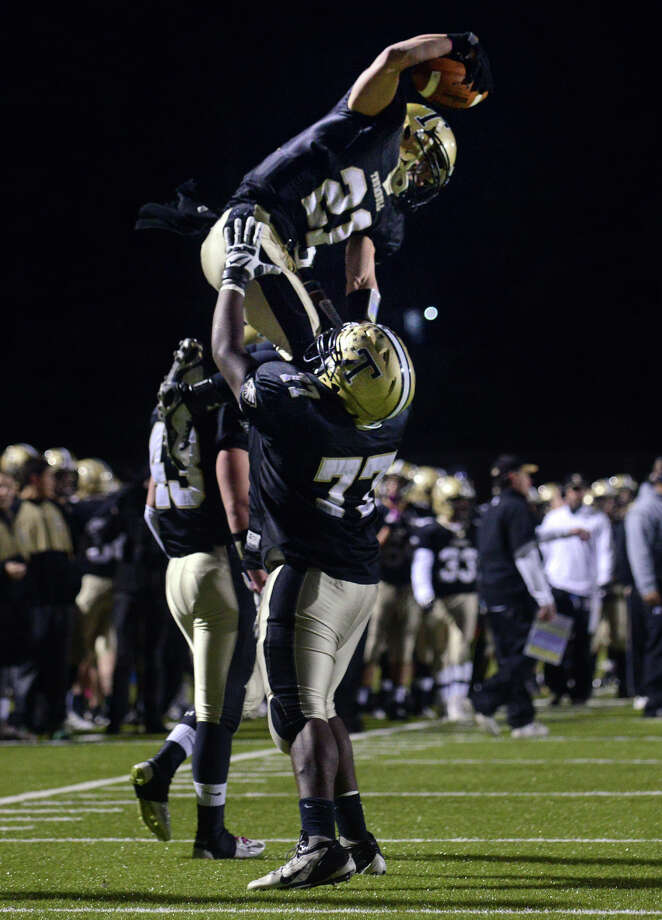 Trumbull High School football player Adam Angelucci is lifted in celebration after a touchdown against St. Joseph Nov. 25, 2014. Town of Trumbull officials are looking at ways to eventually eliminate studentsâÄô pay-to-play fees currently in place for athletic programs, as well as fees charged for music and string programs in elementary schools. Photo: Autumn Driscoll / Connecticut Post