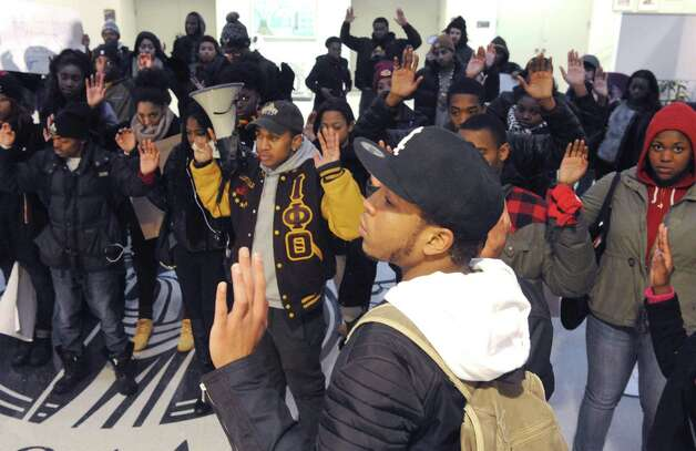 UAlbany students protest the grand jury decision in Ferguson, Mo. Wednesday, Dec. 3, 2014, at University Hall in Albany, N.Y. The protest was organized by Iota Phi Theta fraternity and Zeta Phi Beta sorority. (Michael P. Farrell/Times Union) Photo: Michael P. Farrell