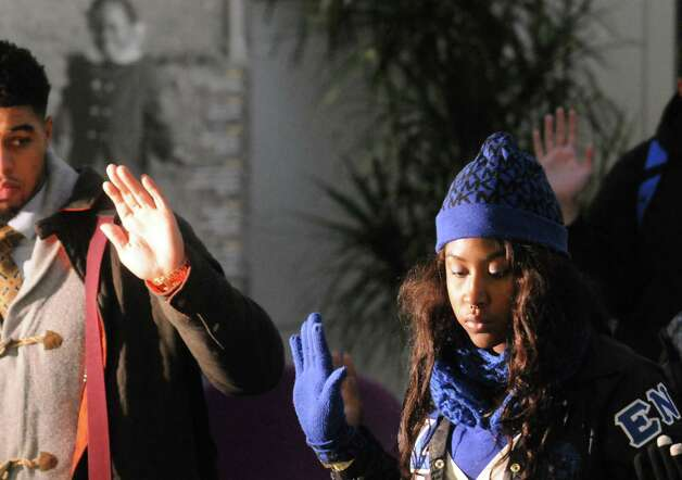 Chyna Monroe, right, is joined by  fellow University at Albany students to demonstrate against the grand jury decision in Ferguson, Mo. Wednesday Dec. 3, 2014, at University Hall in Albany, N.Y. The protest was organized by Iota Phi Theta fraternity and Zeta Phi Beta sorority. (Michael P. Farrell/Times Union) Photo: Michael P. Farrell
