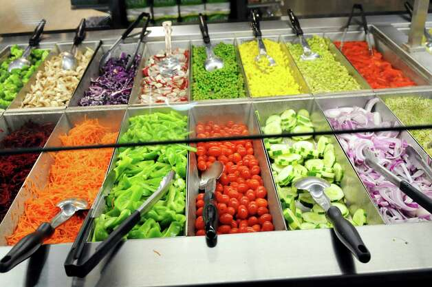 The salad bar at Healthy Living Market and Cafe on Friday, June 7, 2013, at the Wilton Mall in Wilton, N.Y. (Cindy Schultz / Times Union) Photo: Cindy Schultz / 00022739A