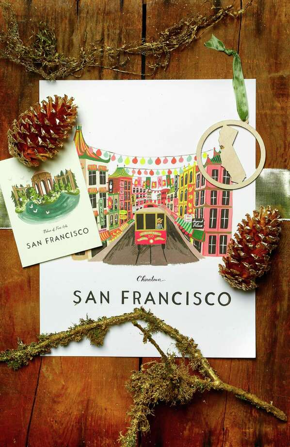 San Francisco pride: Rifle Paper Co. Palace of Fine Arts box set of 8 cards ($20, right) and Chinatown 11 by 14 poster ($42); Kimball Prints laser-cut CA heart ornament ($14), all at Lavish, 508 Hayes St., www.shoplavish.com Photo: Russell Yip / The Chronicle / ONLINE_YES