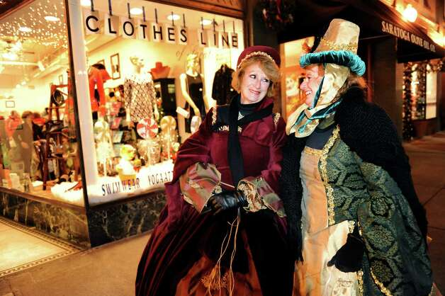 Cheryl Montanye, left, and Lisa O'Day, both on vacation from Hope Sound, Fla. show their Victorian style during the Victorian Streetwalk on Thursday, Nov. 29, 2012, on Broadway in Saratoga Springs, N.Y. (Cindy Schultz / Times Union) ORG XMIT: MER2013112214551692 Photo: Cindy Schultz / 00020251A