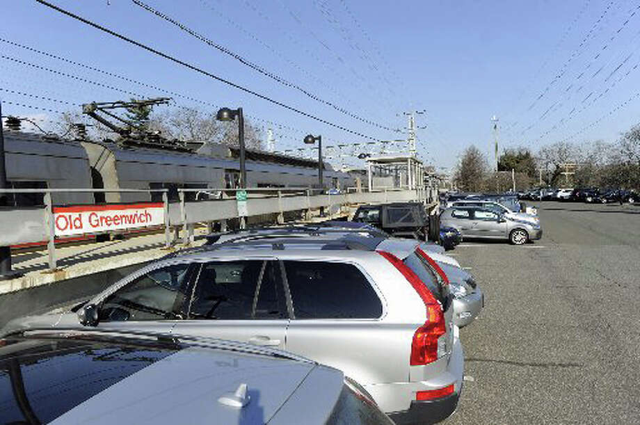 Cars parked at the Old Greenwich train station. The selectmen are to review the price commuters are charged for parking spaces. Photo: File Photo / Greenwich Time File Photo