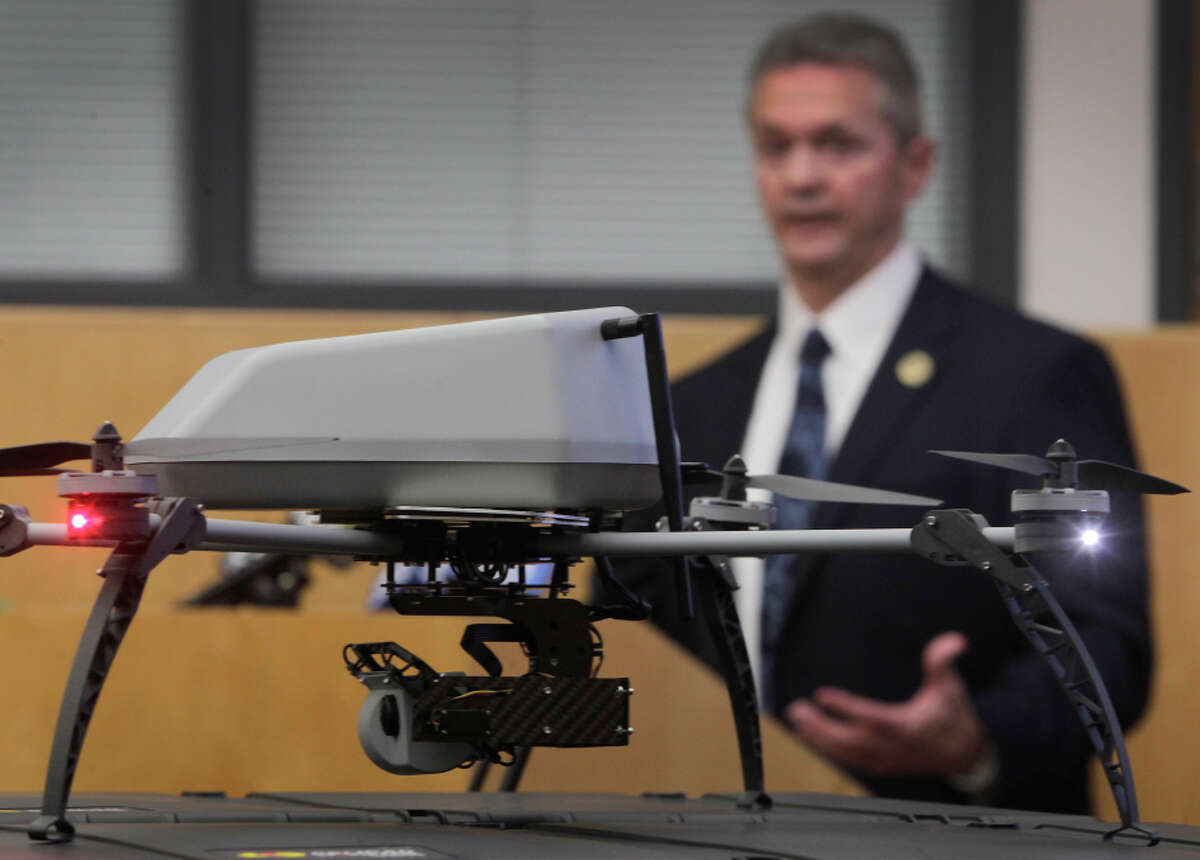 Alameda County Sheriff Gregory Ahern explains how his department plans to use the new drones (foreground).